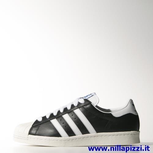adidas nere strisce bianche