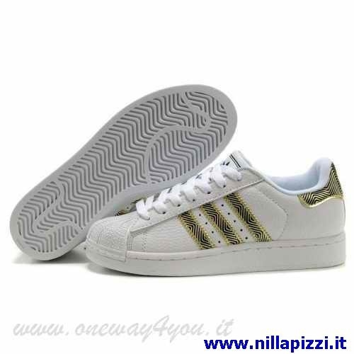 adidas scarpe bianche oro