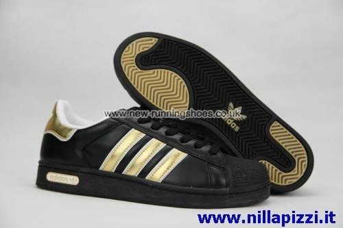 scarpe adidas nere e dorate